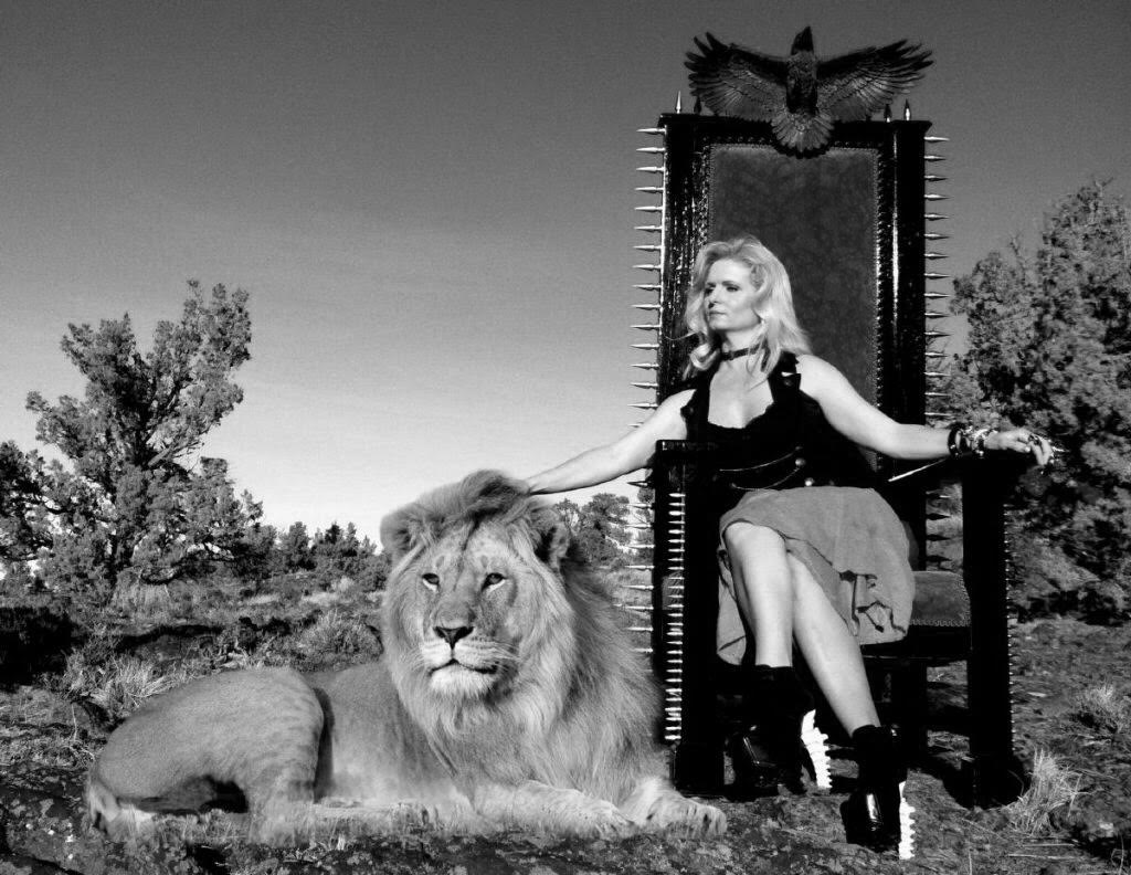 Joanie with lion in a black and white photo